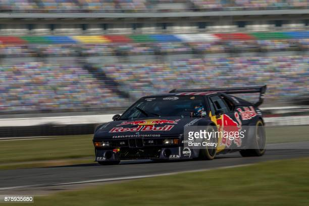 The 1979 BMW M1 of Dieter Quester and Luca Riccitelli races on the track during the Classic 24 at Daytona Historic Sportscar Race at Daytona...