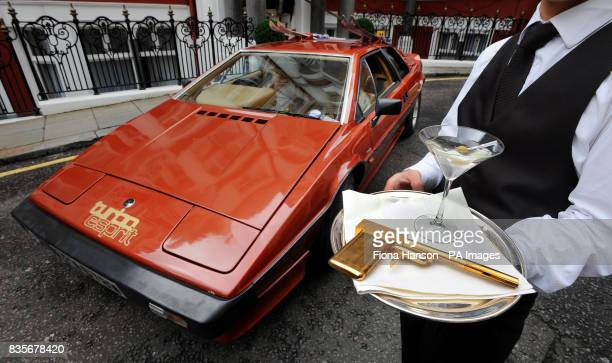 The 1980 Lotus Esprit Turbo driven by Bond actor Roger Moore in the 1981 James Bond film 'For Your Eyes Only' on display in St James's London with a...