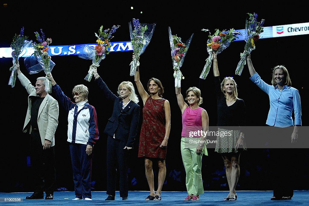 The 1984 United States Women's Gymnastics team including Mary Lou Retton (3rd-R) waves to the crowd before the Women's finals of the U.S. Gymnastics Olympic Team Trials on June 27, 2004 at The Arrowhead Pond of Anaheim in Anaheim, California.