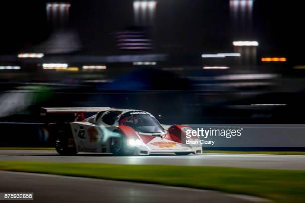 The 1985 Porsche Fabcar of John Higgins races on the track at night during the Classic 24 at Daytona Historic Sportscar Race at Daytona International...