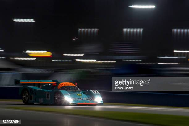 The 1987 Porsche 962 of Tommy Dreelan and Aaron Scott races on the track at night during the Classic 24 at Daytona Historic Sportscar Race at Daytona...