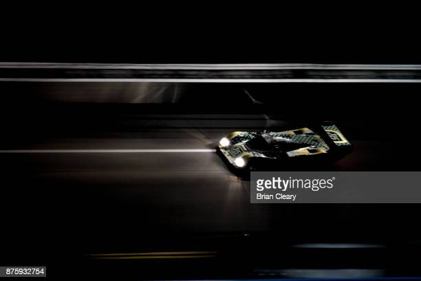 The 1989 Porsche 962 of Henrick Lindberg races on the track at night during the Classic 24 at Daytona Historic Sportscar Race at Daytona...