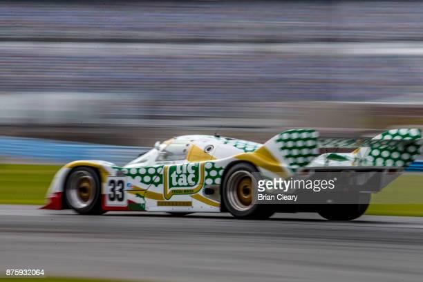 The 1989 Porsche 962 of Henrick Lindberg races on the track at the Classic 24 at Daytona Historic Sportscar Race at Daytona International Speedway on...