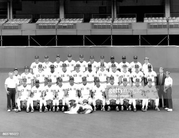The 1990 Cincinnati Reds pose for a team photo team mascot Schottzie Chris Sabo Billy Hatcher Luis Quinones coach Jackie Moore coach Tony Perez...