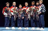 The 1996 US Women's Gymnastic's Olympic Team Kerri Strug Jaycie Phelps Dominique Moceanu Shannon Miller Dominique Dawes Amy Chow and Amanda Borden...