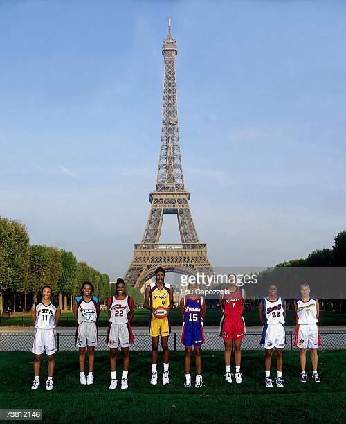 The 1997 WNBA Tour team poses for a photo outside the Eiffel Tower in Paris France NOTE TO USER User expressly acknowledges that by downloading and...