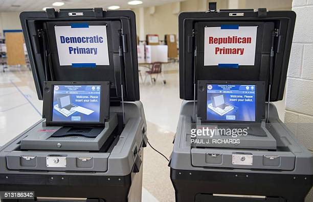 The DS200 optical scanners used to count the votes of Fairfax County primary voters are seen at Centreville High School March 1 during the Super...