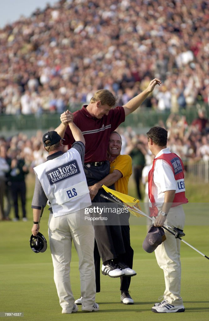 The 2002 British Open Golf Championship, Muirfield, Scotland, 21st July 2002, Winner Ernie Els of South Africa is lifted up by second placed Thomas Levet of France on the 18th green, Els defeated Levet in a sudden death play-off on the 18th hole,Credit: POPPERFOTO