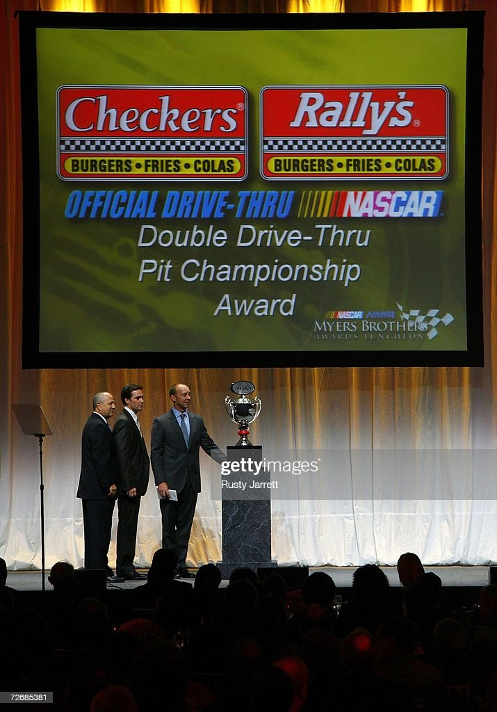 The 2006 NASCAR Nextel Cup Series Champion Jimmie Johnson and the 2006 NASCAR Nextel Cup Series Champion crew chief Chad Knaus receive the Checkers...