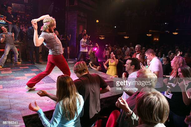 The 2007 National Air Guitar Champion Andrew 'William Ocean' Litz joins the cast members and audience of the musical 'Rock of Ages' to break the...