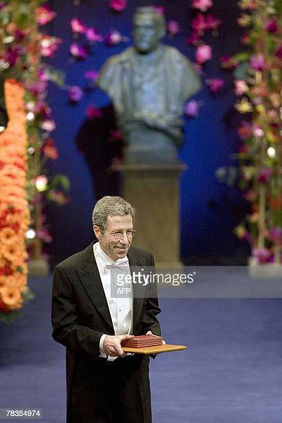 The 2007 Nobel Prize Winner in economics Eric Maskin of US is pictured after receiving his medal from the Swedish King Carl XVI Gustaf in the concert...