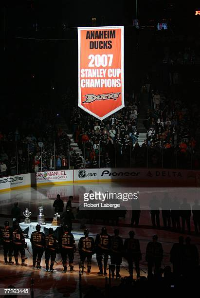 The 2007 Stanley Cup Champions banner is lifted to the rafters of the Honda Center as the Anaheim Ducks look on before their game against the Boston...