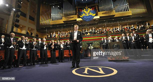 The 2008 Nobel Prize winner in Literature French writer JeanMarie Gustave Le Clézio bows to the applause after receiving his medal in the concert...
