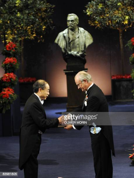 The 2008 Nobel Prize Winner in physics Makoto Kobayashi of Japan receives his medal from Swedish King Carl XVI Gustaf at the concert hall in...