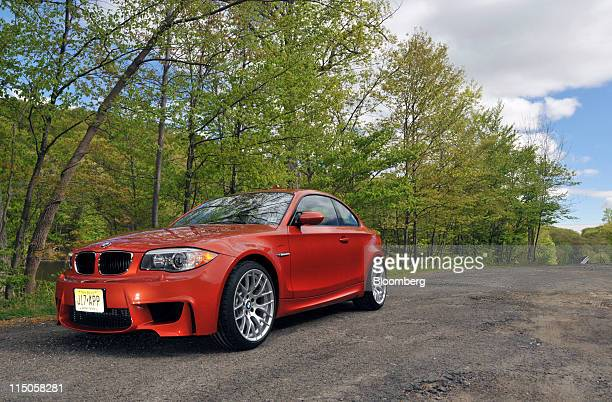 The 2011 BMW 1M coupe is seen near Monticello New York US on Wednesday May 11 2011 Powered by a 335horsepower twin turbocharged inlinesix cylinder...