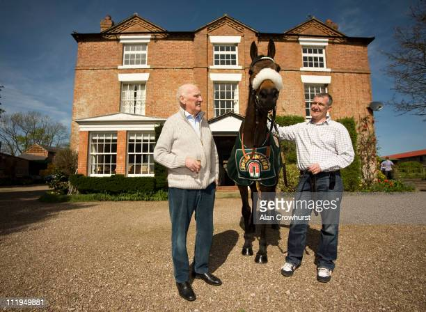 The 2011 Grand National winner Ballabriggs poses with trainer Donald McCain and Donald's father Ginger McCain who trained Red Rum to win the same...