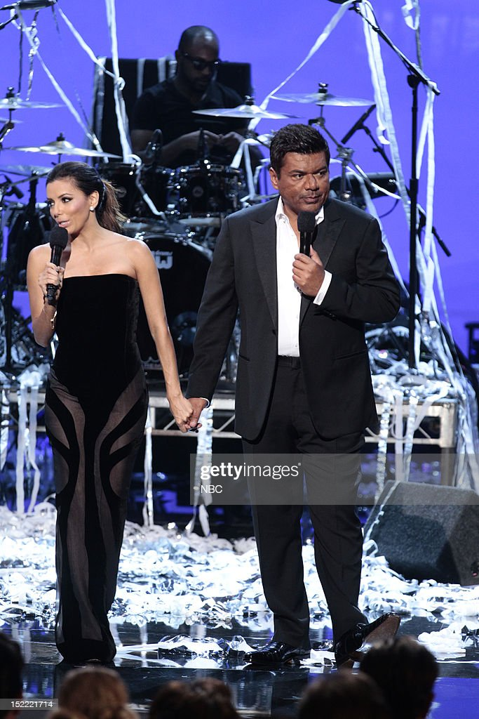 AWARDS -- The 2012 NCLR ALMA Awards 'Show' -- Pictured: (l-r) <a gi-track='captionPersonalityLinkClicked' href=/galleries/search?phrase=Eva+Longoria&family=editorial&specificpeople=202082 ng-click='$event.stopPropagation()'>Eva Longoria</a>, <a gi-track='captionPersonalityLinkClicked' href=/galleries/search?phrase=George+Lopez&family=editorial&specificpeople=202546 ng-click='$event.stopPropagation()'>George Lopez</a> at the 2012 NCLR ALMA Awards held at the Pasadena Civic Auditorium on September 16, 2012 --