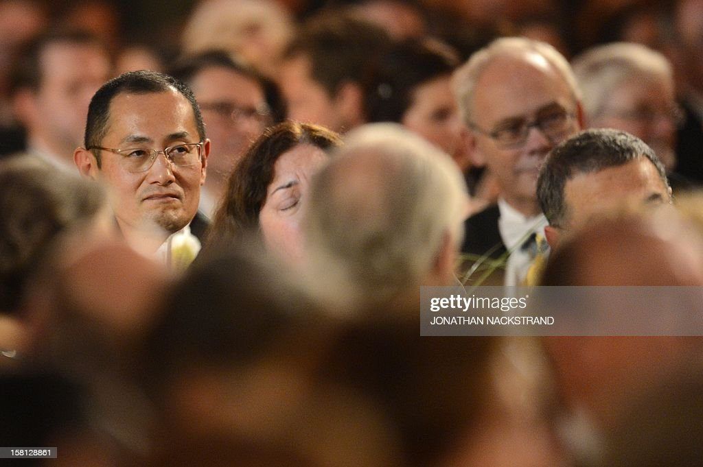 The 2012 Nobel Physiology or Medecine Prizewinner Shinya Yamanaka of Japan (L) is pictured during the Nobel Banquet, a traditional dinner, after the Nobel Prize awarding ceremony at the Stockholm City Hall, on December 10, 2012. The winners of the Nobel Prize 2012 in the categories of medicine, physics, chemistry, literature and economics received their awards from the hands of Sweden's King Carl XVI Gustaf at a formal ceremony, followed by a gala banquet. AFP PHOTO/JONATHAN NACKSTRAND .
