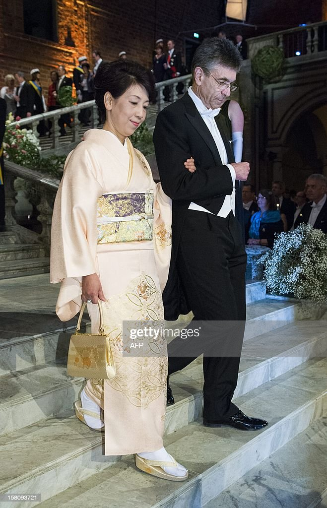 The 2012 Nobel Prize Laureate for Chemistry Professor Robert J Lefkowitz (R) of USA and Dr Chika Yamanaka of Japan, wife of Nobel Prize Laureate for Physiology or Medicin Professor Shinya Yamanaka arrive for the traditional dinner after the Nobel Prize awarding ceremony at the Stockholm City Hall, on December 10, 2012, Sweden.