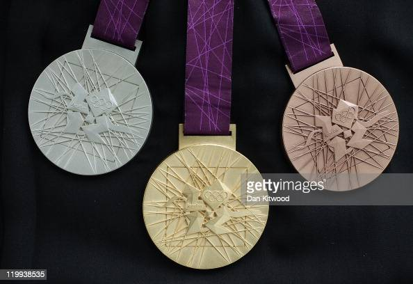 The 2012 Olympic games medals designed by David Watkins are unveiled ahead of the 'London 2012 One Year To Go' ceremony at LOCOG headquarters Canary...