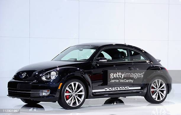 The 2012 Volkswagen Beetle sits on display during its US reveal at Warehouse at Pier 36 on April 18 2011 in New York City The car will be available...