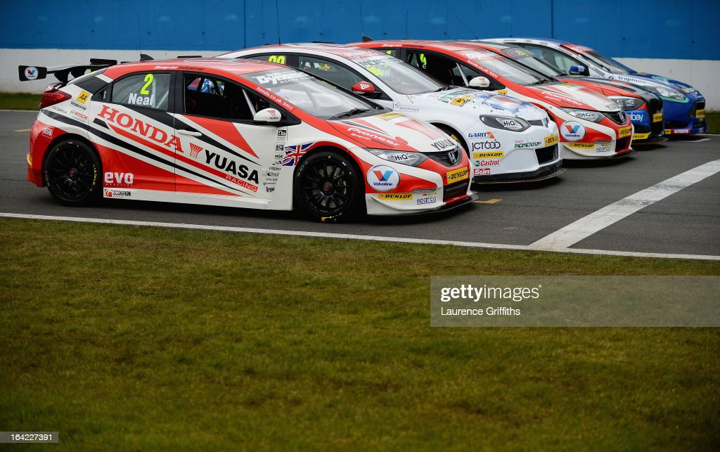 The 2013 British Touring Car Championship cars line up on the grid during the BTCC Media Day at Donington Park on March 21, 2013 in Castle Donington, England.