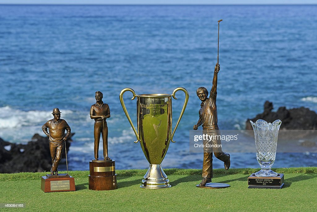 KA'UPULEHU-KONA, HI - JANUARY 16: The 2013 Champions Tour player awards (From L to R) The Byron Nelson Award, The Arnold Palmer Award, The Charles Schwab Cup, The Jack Nicklaus Award and the Rookie of the Year trophy during the Thursday Pro Am at the Mitsubishi Electric Championship at Hualalai Golf Club on January 16, 2014 in Ka'upulehu-Kona, Hawaii.