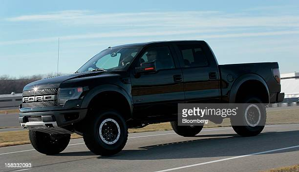 The 2013 Ford Motor Co F150 SVT Raptor truck sits parked on the test track at the company's Dearborn Development Center in Dearborn Michigan US on...