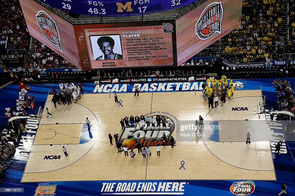 The 2013 Hall of Fame Class inductees stand on the court as the Naismith Memorial Basketball Hall of Fame 2013 Class On Court Announcement is made during the 2013 NCAA Men's Final Four Championship between the Michigan Wolverines and the Louisville Cardinals at the Georgia Dome on April 8, 2013 in Atlanta, Georgia.
