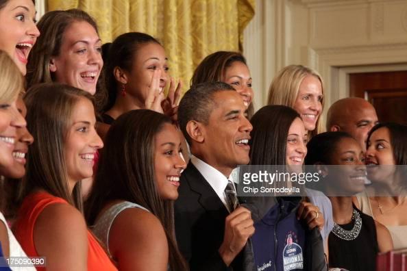 The 2013 NCAA champion University of Connecticut Huskies Women's basketball players Stefanie Dolson and Kiah Stokes give President Barack Obama...