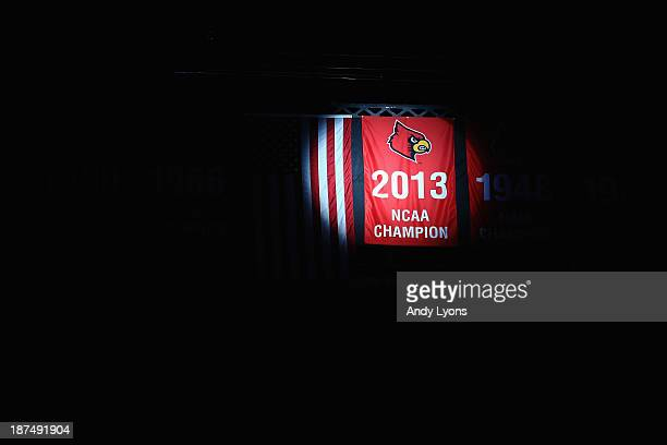 The 2013 NCAA National Championship banner is unvieled before the Louisville Cardinals game against the College of Charleston Cougars at KFC YUM...