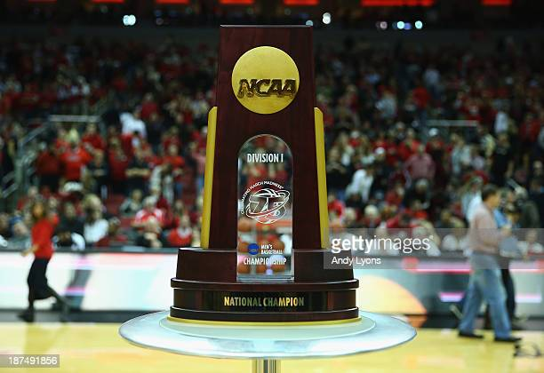 The 2013 NCAA National Championship trophy sits a half court before the Louisville Cardinals game against the College of Charleston Cougars at KFC...