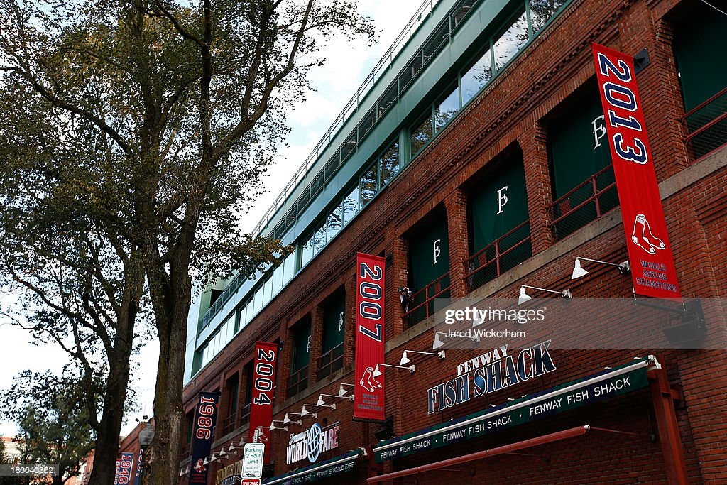 The 2013 World Series Champions banner hangs outside of Fenway Park prior to the World Series victory parade at Fenway Park on November 2, 2013 in Boston, Massachusetts.