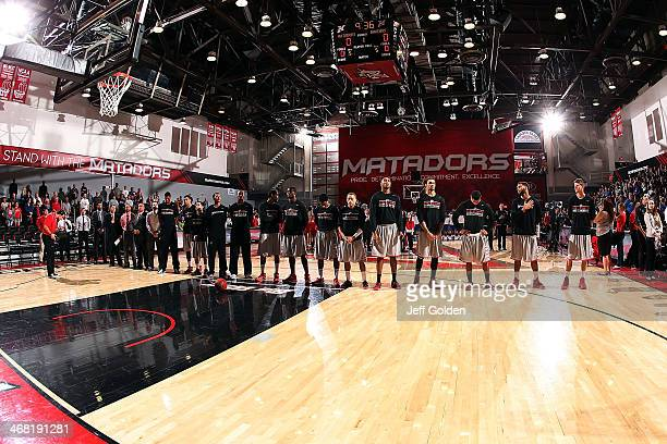 The 20132014 Cal State Northridge Matadors stand for the National Anthem before the game against the UC Santa Barbara Gauchos at The Matadome on...