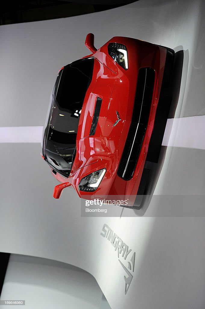 The 2014 Chevrolet Corvette Stingray is displayed on a wall during the 2013 North American International Auto Show (NAIAS) in Detroit, Michigan, U.S., on Tuesday, Jan. 15, 2013. The Detroit auto show runs through Jan. 27 and will display over 500 vehicles, representing the most innovative designs in the world. Photographer: David Paul Morris/Bloomberg via Getty Images