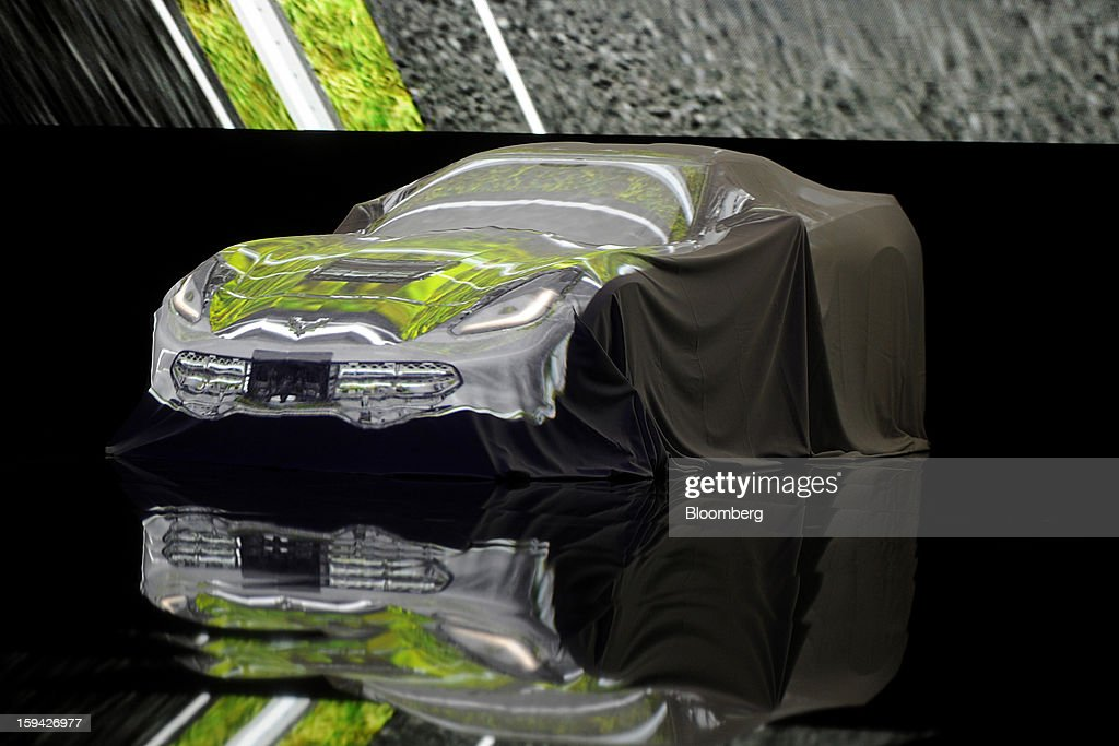 The 2014 Chevrolet Corvette Stingray sits covered during the unveiling ahead of the 2013 North American International Auto Show (NAIAS) in Detroit, Michigan, U.S., on Sunday, Jan. 13, 2013. The new model, set to reach dealers in this year's third quarter, is part of the push to breathe new life into the Chevy brand, which accounted for 71 percent of GM's 2012 U.S. sales. Photographer: Daniel Acker/Bloomberg via Getty Images