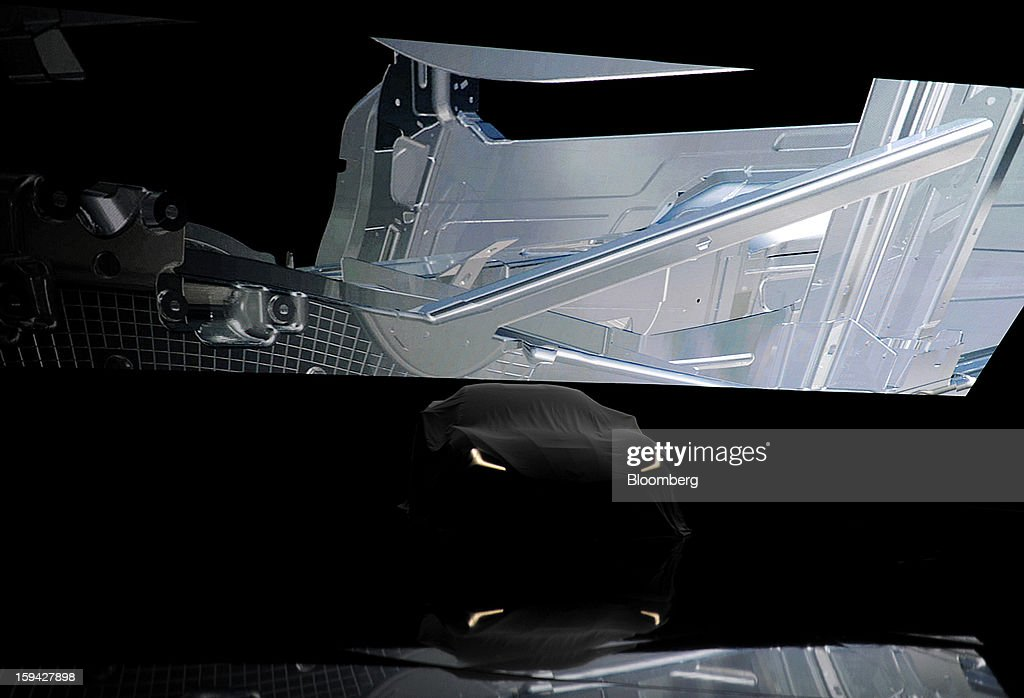 The 2014 Chevrolet Corvette Stingray sits covered during the unveiling ahead of the 2013 North American International Auto Show (NAIAS) in Detroit, Michigan, U.S., on Sunday, Jan. 13, 2013. The new model, set to reach dealers in this year's third quarter, is part of the push to breathe new life into the Chevy brand, which accounted for 71 percent of GM's 2012 U.S. sales. Photographer: David Paul Morris/Bloomberg via Getty Images