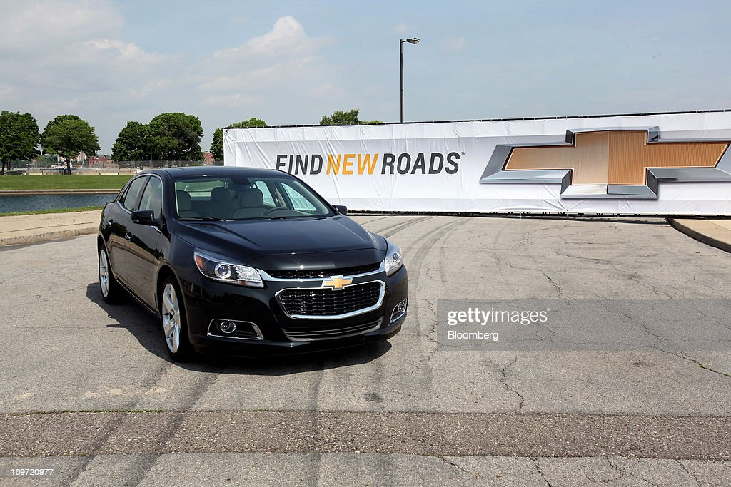 The 2014 Chevrolet Malibu is unveiled at the Belle Isle Grand Prix racetrack in Detroit, Michigan, U.S., on Friday, May 31, 2013. General Motors Co., after failing to gain sales with its redesigned Chevrolet Malibu last year, said it's developed an updated version of the mid-size sedan with a sportier front end, roomier back seat and better fuel efficiency. Photographer: Fabrizio Costantini/Bloomberg via Getty Images