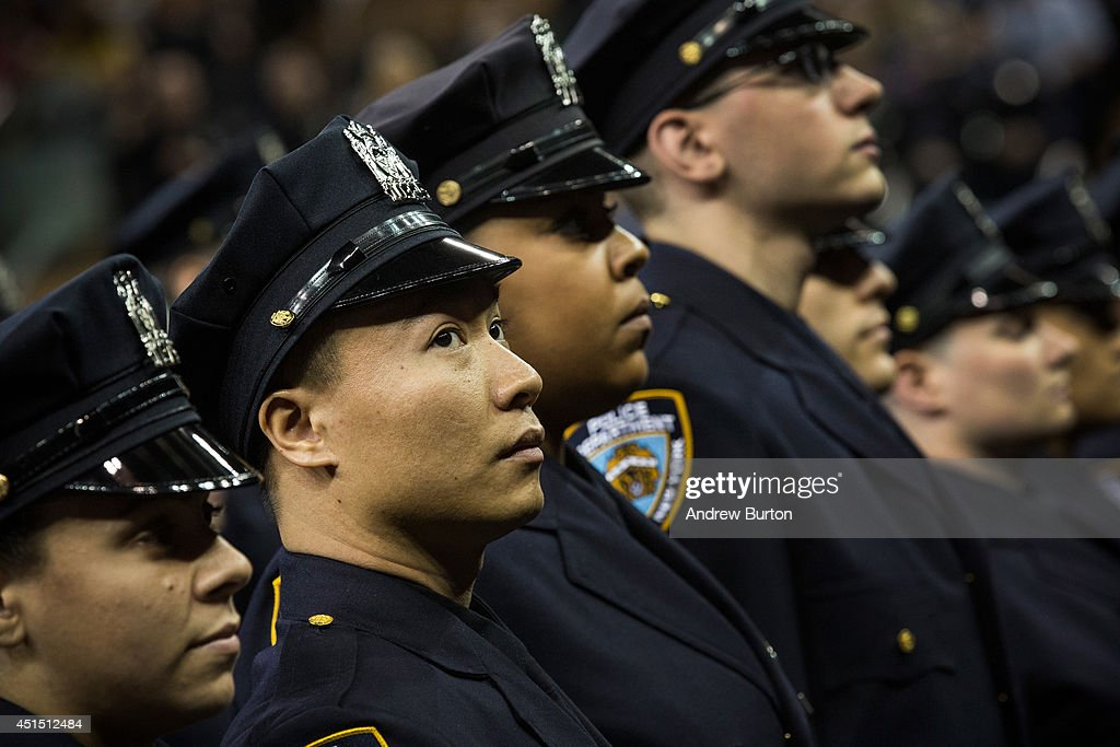 The 2014 class of the New York Police Department attend the NYPD graduation ceremony on June 30 2014 at Madison Square Garden in New York City The...