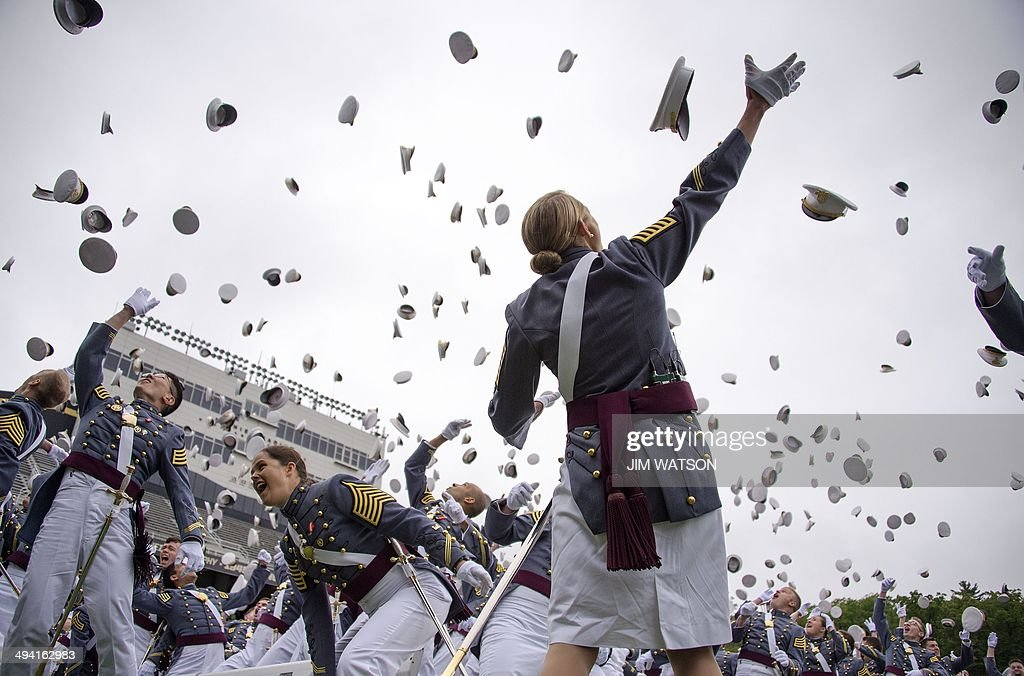 The 2014 graduating class at the United States Military Academy at West Point, New York, throw their covers in the air at the end of the ceremony May 28, 2014. AFP PHOTO / Jim WATSON