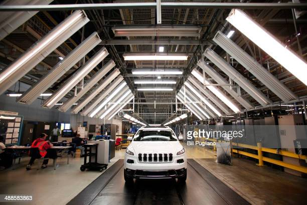 The 2014 Jeep Cherokee undergoes assembly at the Chrysler Toledo North Assembly Plant Jeep May 7 2014 in Toledo Ohio Fiat Chrysler Automobiles...