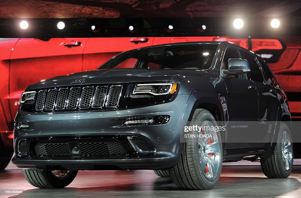The 2014 Jeep Grand Cherokee SRT high performance version is introduced at the 2013 North American International Auto Show in Detroit, Michigan, January 14, 2013. AFP PHOTO/Stan HONDA