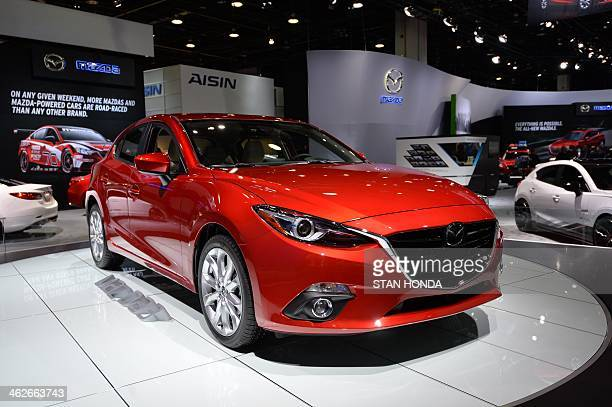 The 2014 Mazda 3 sedan is seen during a press preview at the North American International Auto Show January 14 2014 in Detroit Michigan AFP...