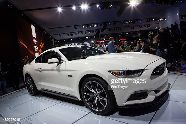 The 2015 50th anniversary Ford Mustang is introduced during a media preview of the New York International Auto Show April 16 2014 in New York City...