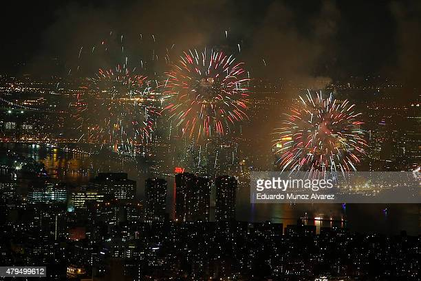 The 2015 Macy's 4th of July Fireworkss are seen along East river from the One World Trade Center Observatory on July 4 2015 in New York City The...