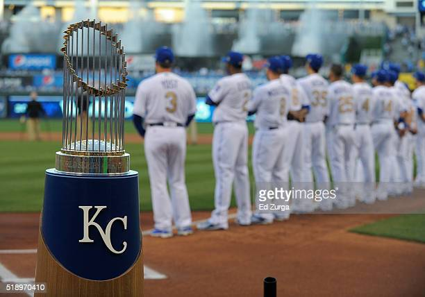 The 2015 World Series Trophy rest at home plate as members of the Kansas City Royals are introduced prior to a game against the New York Mets at...