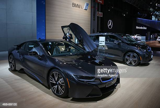 The 2016 BMW i8 and BMW i3 are displayed during the New York International Auto Show on April 2 2015 in New York City