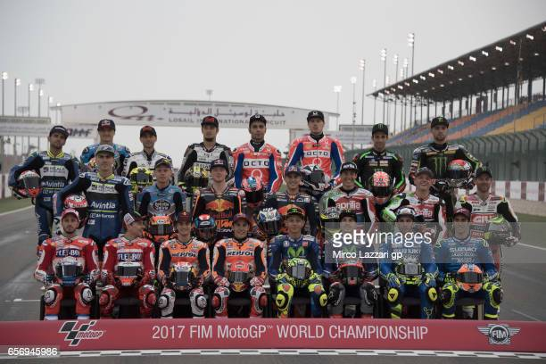 The 2017 MotoGP riders pose on track for the official photo during the MotoGp of Qatar Free Practice at Losail Circuit on March 23 2017 in Doha Qatar