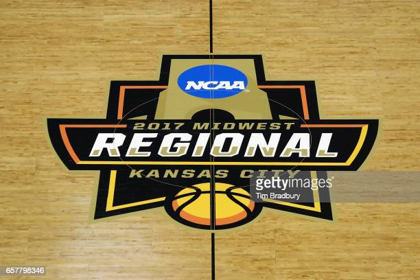 The 2017 NCAA Men's Basketball Tournament Midwest Regional logo is seen on the court before the game between the Oregon Ducks and the Kansas Jayhawks...