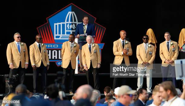 The 2017 NFL Hall of Fame class on the stage during introductions by Chris Berman including Dallas Cowboys owner Jerry Jones and former TCU running...